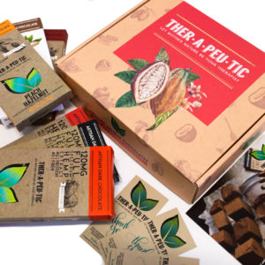 a theratreats subscription box with individual chocolate bars surrounding it